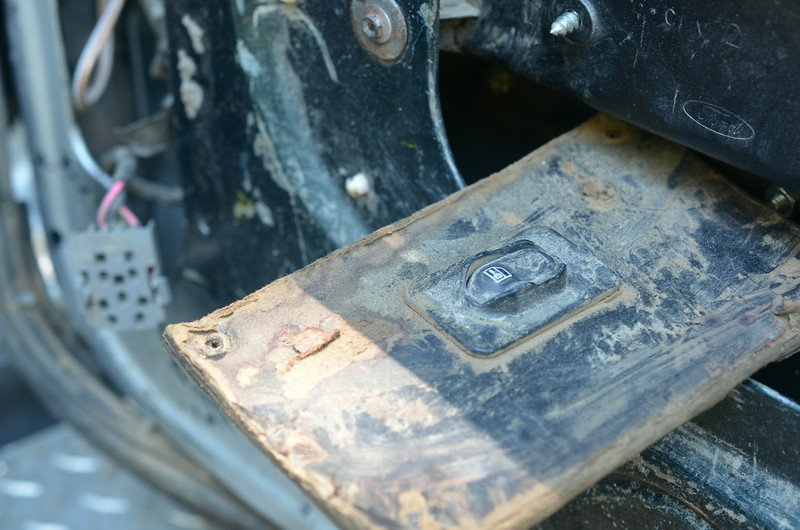 Rear door automatic lock switch found hiding in a hole